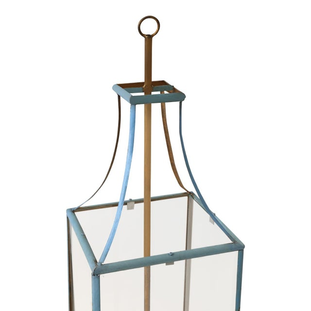 Large rectangular iron lantern: simple, elegant wrought iron lantern, painted in light blue accented by a gilt-iron...