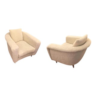 Jean Royère Pair of Armchairs With Tapered Metal Sabot Covered in Faux Fur For Sale