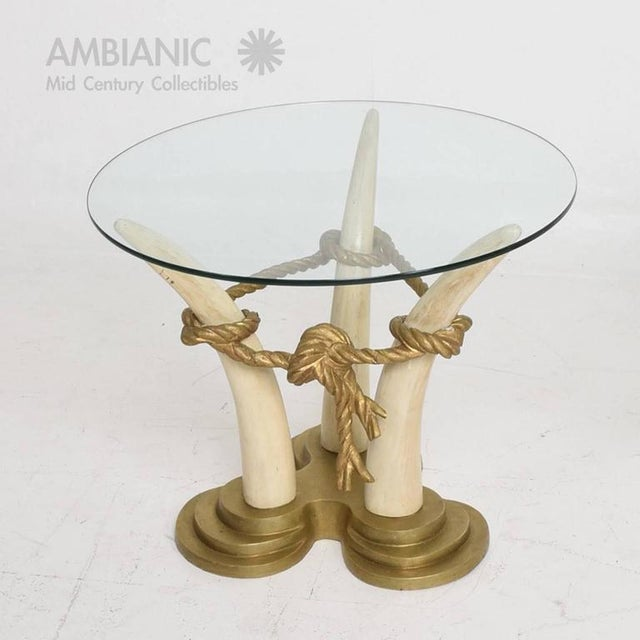 For your consideration a pair of Hollywood Regency-style side tables in bronze and faux ivory with glass tops. Made by...