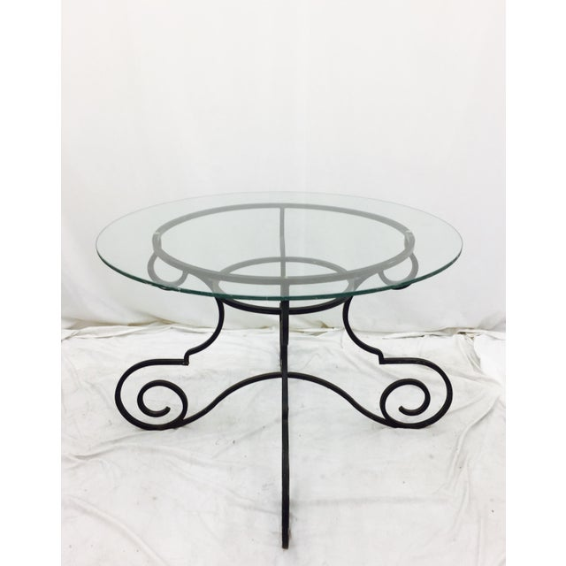 "Vintage Black Wrought Iron Table with Round 41.5"" Glass Top. Top: 41.5"" round and almost 1/2"" Thick. Shows wear. Classic..."