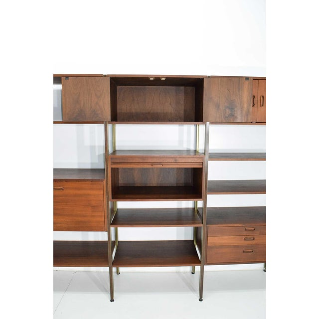 This is a beautiful Omni bookcase and storage system by George Nelson for Structural Products. Unit is walnut with bronze...