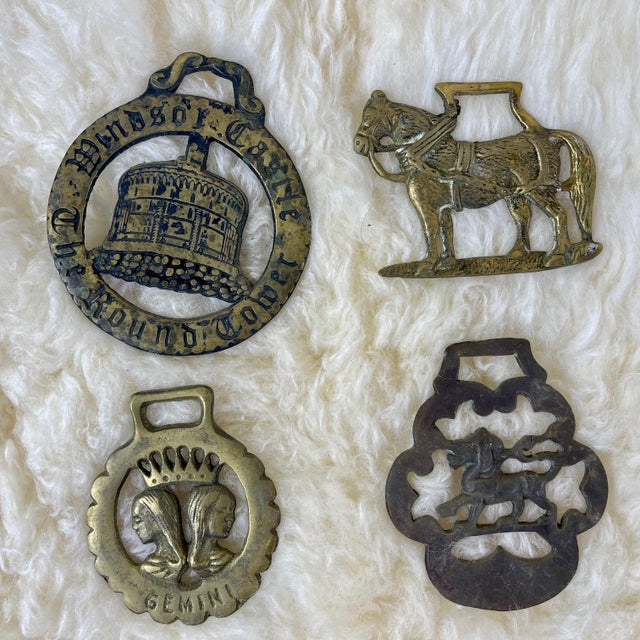 Set of 12 antique English horse brass ornaments. Horse brasses were used to decorate shire and parade horses for special...