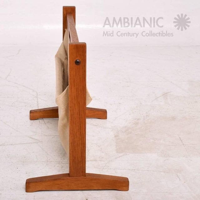 """For your consideration a Danish modern teak and canvas magazine holder. Stamped with makers label underneath """"BRDR. FURBO""""..."""
