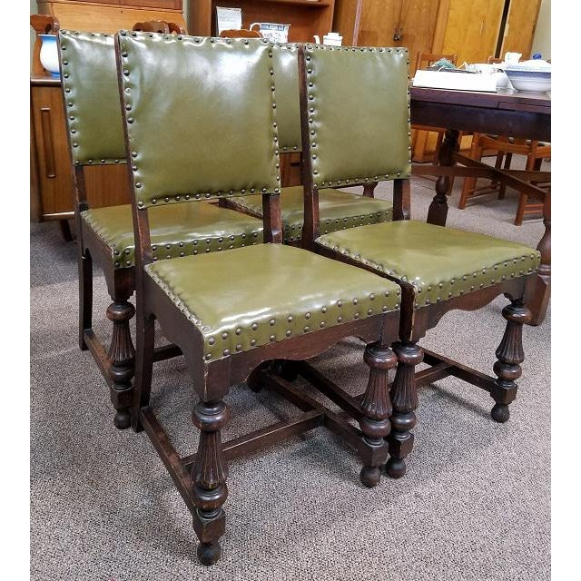 Set of Four Vintage Oak Dining Chairs w/ Green Leather Seats c.1920s This is a fantastic set of English Oak dining chairs....