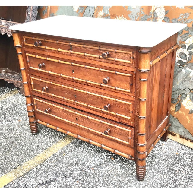 19th century American faux bamboo chest of drawers. The top is Carrara marble, and follows down to simple sides with hand...