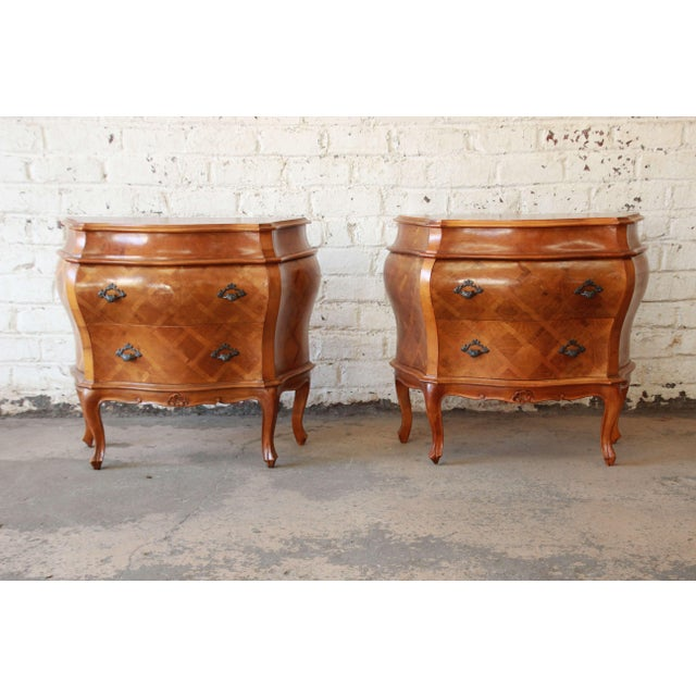 Offering an exceptional pair of parquetry inlaid Italian bombay chest nightstand. The pair of chests have a beautiful...