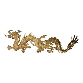 Asian Cast Brass Dragon Chasing a Ball, Wall Mount For Sale