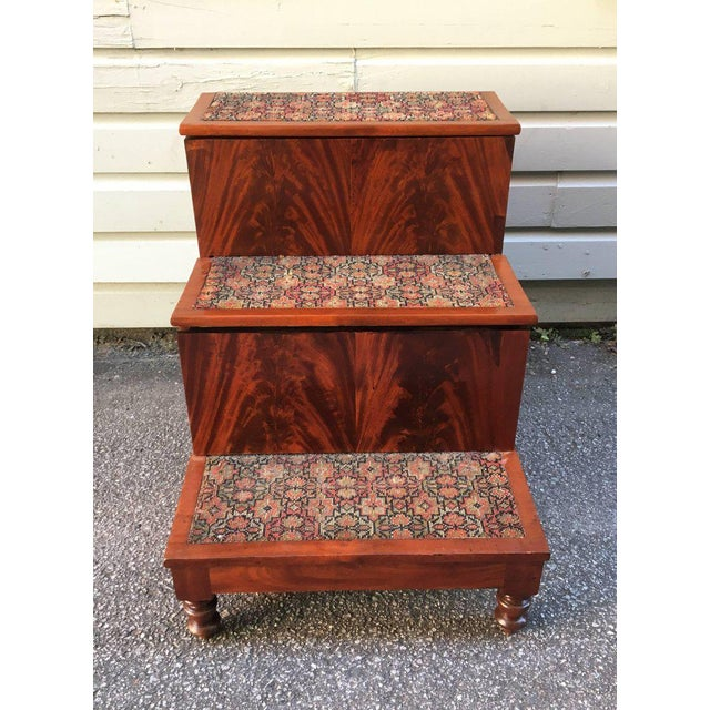 These Southern North American bed steps have bookmatched flame mahogany on the risers. The turned Federal legs are solid...