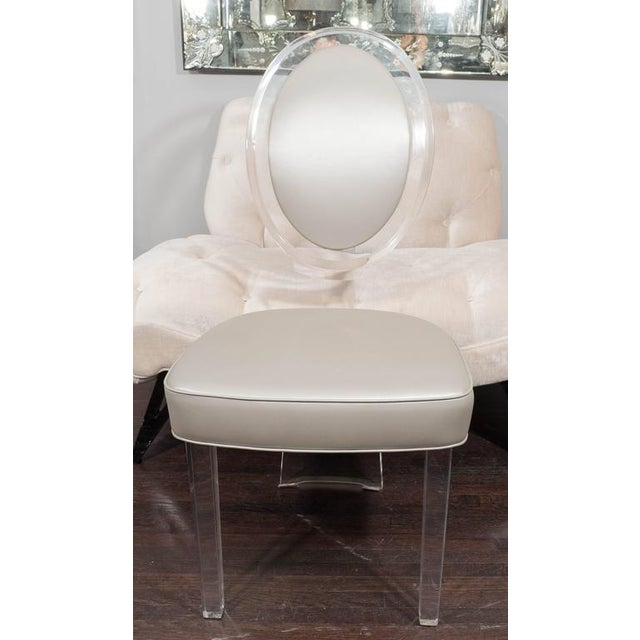 1970s Lucite baloon back chair. Reupholstered in metallic vinyl.