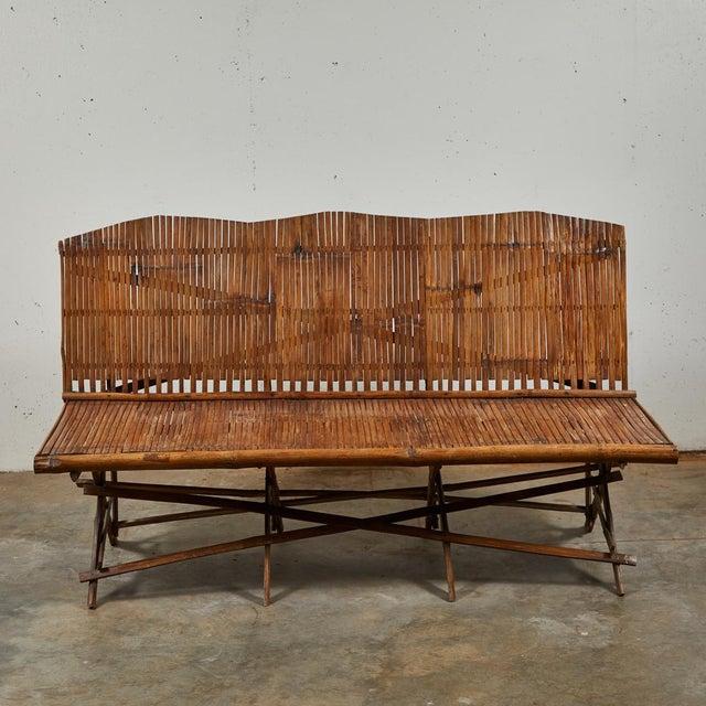 A bamboo slated country bench, England, circa 1920.