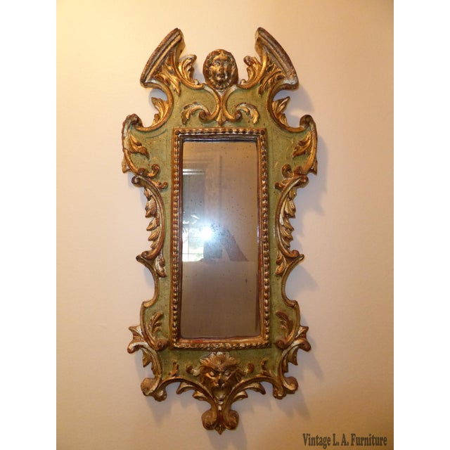 Vintage Rococo green & gold gilt carved solid wood wall mirror made in Italy. Gorgeous mirror in great vintage condition....