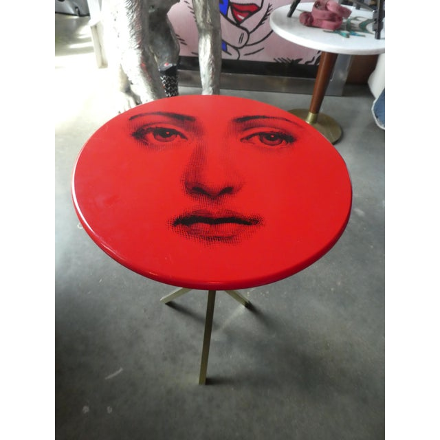 Vintage Fornasetti red Julia table. Sold as found previously owned without damage.