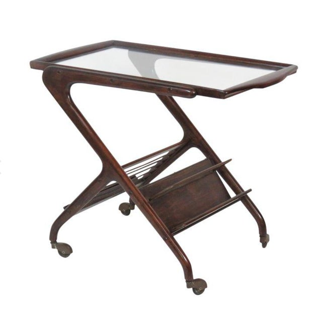Iconic Ico Parisi style bar cart with walnut frame with and glass top. Great vintage condition. This is the perfect bar...