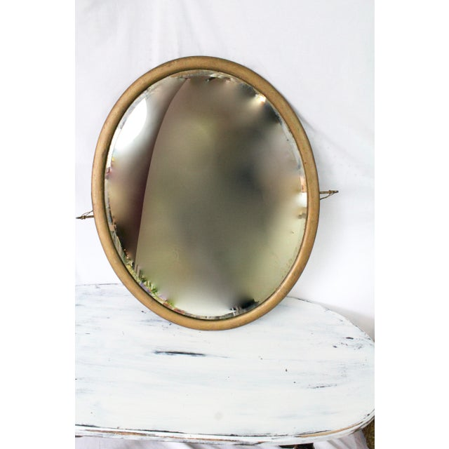 This very well maintained turn of the century, wooden vanity mirror has been painted gold. It's simple design is a classic...