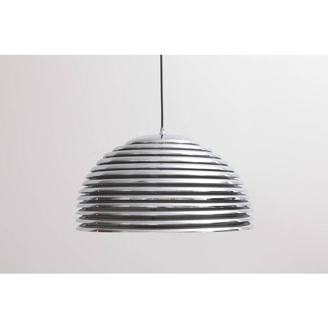 Rare large version of the Kazuo Motozawa Saturno pendant light by Staff in chrome. The inside lacquer is peeling off. That...