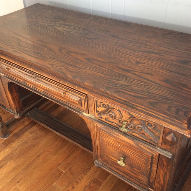 Rustic, dark oak desk of Jacobean style, made late 19th or early 20 th century by Feudal Oak Jamestown Lounge Co. Metal...