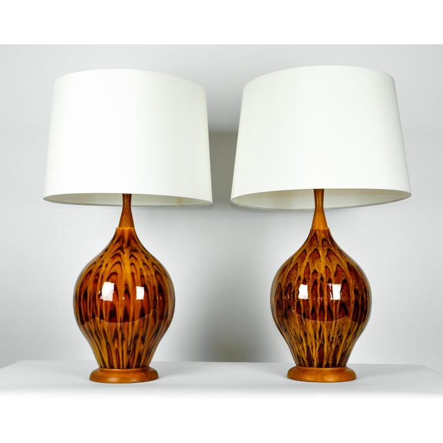 Vintage Italian glazed porcelain pair table lamps. Each lamp is in excellent working condition. Each lamp measures 31...