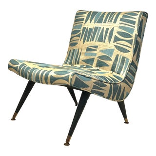 This Mid-Century Modern Upholstered Fabric Scoop Armless Side Chair For Sale