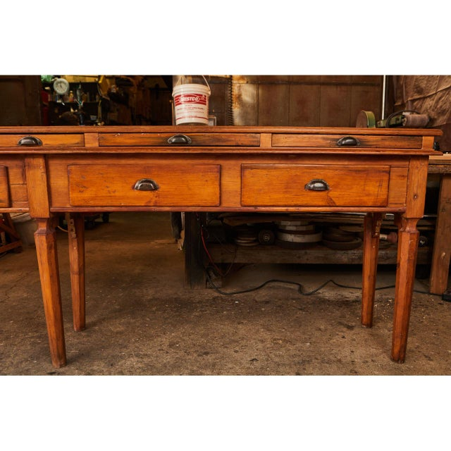 This lovely Italian pine sideboard has a unique design aesthetic that represents the period. The piece has eight sided...