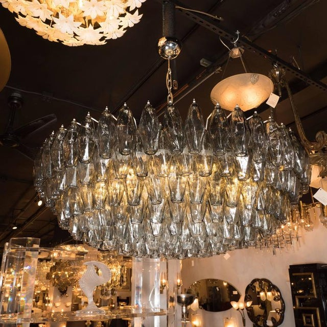 This impressive Murano glass chandelier, in the manner of Venini, features a constellation of handblown Murano glass...