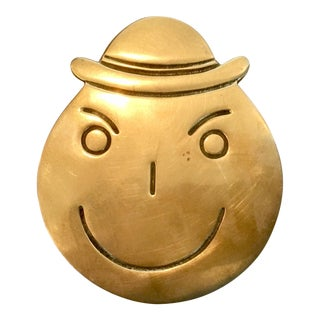 Bonwit Teller Mid-Century Brass Sneaky/Mischievous Face Paperweight For Sale