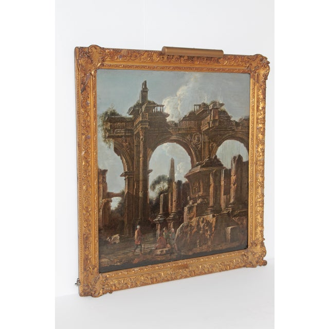 This 17th century capriccio / painting is labeled Giovanni Paolo Panini, 1691-1765, but we believe it to be earlier, by...