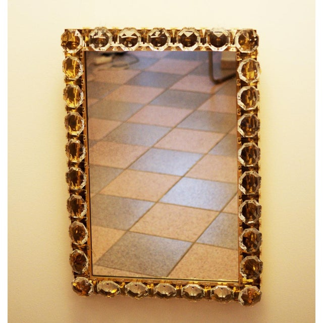 This vintage mirror was designed by Bakalowits & Sohne in the 1960s and manufactured in Vienna. It has a gold-plated frame...