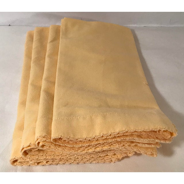 Set of four beautiful yellow napkins with a embroidered edge. They will make a great addition to a retro dining table!