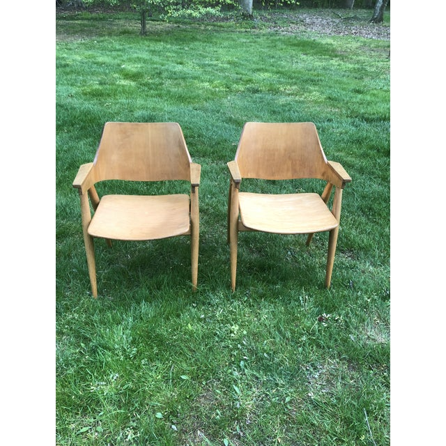 Rare pair of Thonet arm chairs. Modern form ( believed to be by Pierre Pauline ), in an all wood configuration. Lightly...