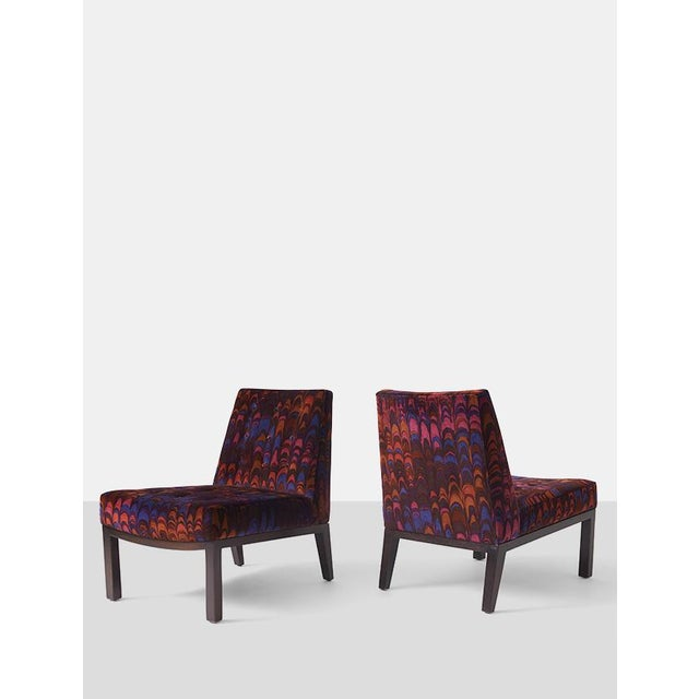 """A pair of armless """"Sophia"""" lounge chairs with black bases. Covered in their original Jack Lenor Larsen velvet fabric and..."""