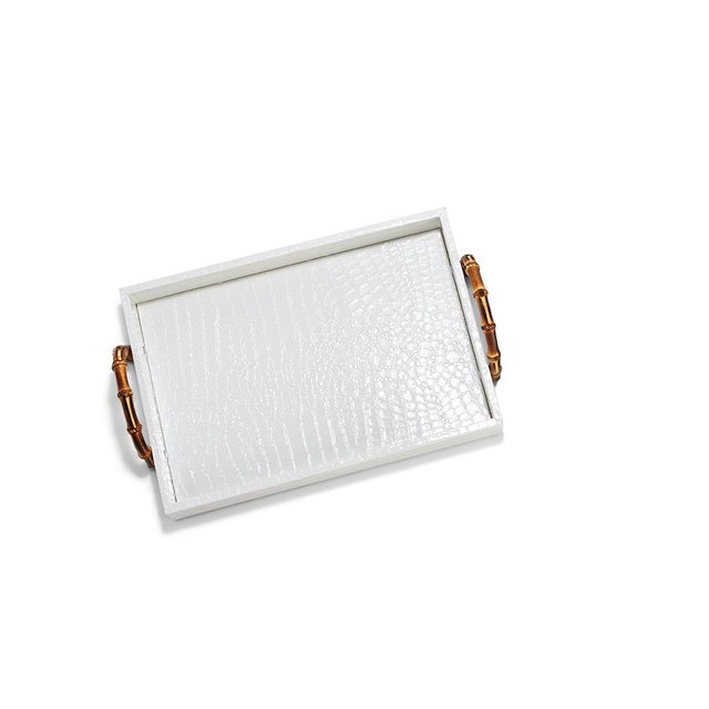 Small white faux leather crocodile tray with bamboo handles.