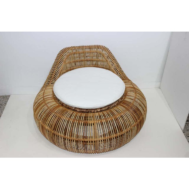 This stylish and chic rattan chair is attributed to Franco Albini and was acquired from a Palm Beach estate. The canvas...