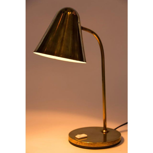 1950s brass table lamp attributed to Jacques Biny. A exceptionally clean and simple design executed in patinated brass...
