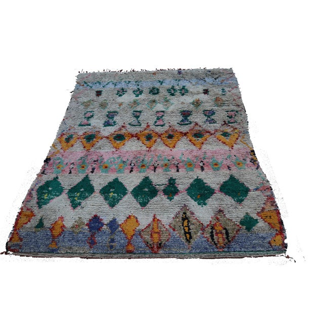 "One of a kind vintage rag rug from Morocco. Also known as a ""BOUCHEROUITE"" rug. handwoven in the Atlas Mountains. This rug..."