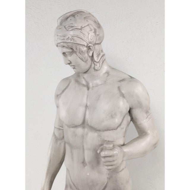 This is an over sized 20th Century plaster statue of a Greek warrior in the classical style. Scales to 34 inches tall with...