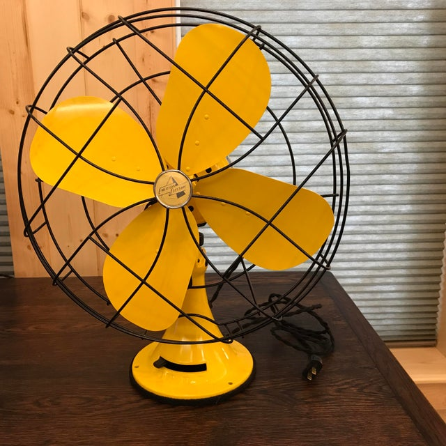 This gorgeous mid century bright yellow Emerson electric fan is sure to be a conversation piece. It is a 1952 model...