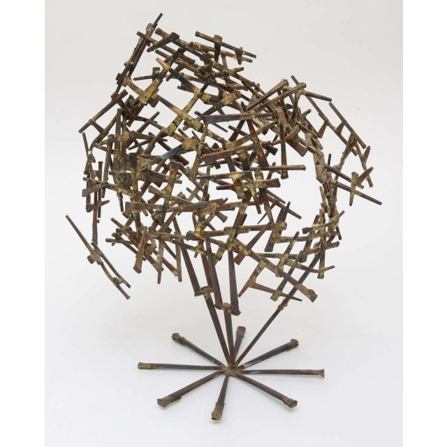 Gilded Cement Nails going in all directions make this one of a kind tabletop abstract sculpture interesting. it looked...