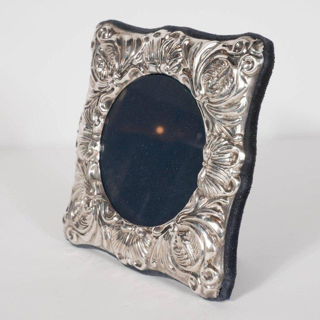 This charming picture frame features a circular glass sheet in the centre, surrounded on all sides by Baroque detailing in...