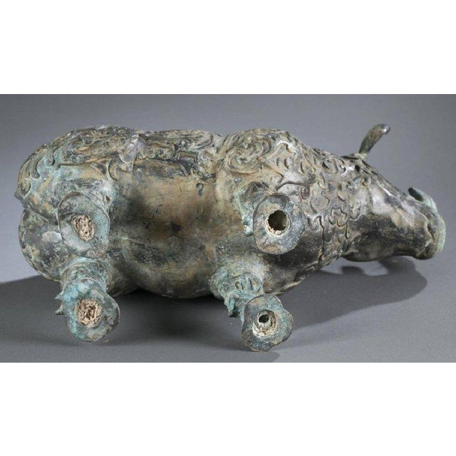 Chinese Bronze Rhinoceros Statues With Decorative Relief Pattern - a Pair For Sale - Image 9 of 10