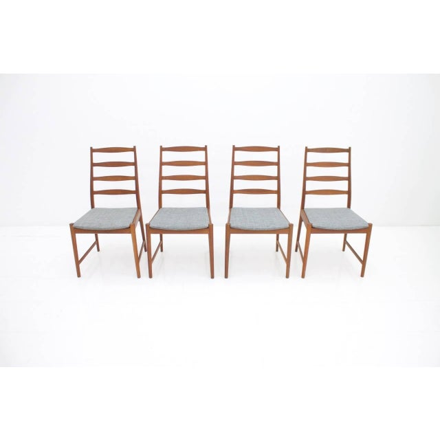 Set of four teak wood dining chairs by Torbjørn Afdal Model 113 for Vamo Sonderborg 1965 Solid teak wood and new grey...