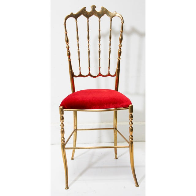 Stunning Italian polished brass Chiavari chair with bat motif and red velvet upholstery, circa 1960s. Designed by Giuseppe...