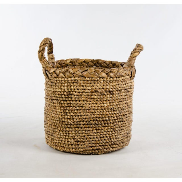 A basket with endless possibilities! This modern woven seagrass basket can provide storage space for craft supplies or...