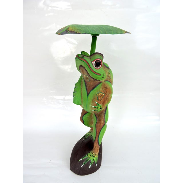 Cool lime green frog hand carved and painted in Bali, Indonesia in the 70's. Sheltering under his leaf umbrella, this...