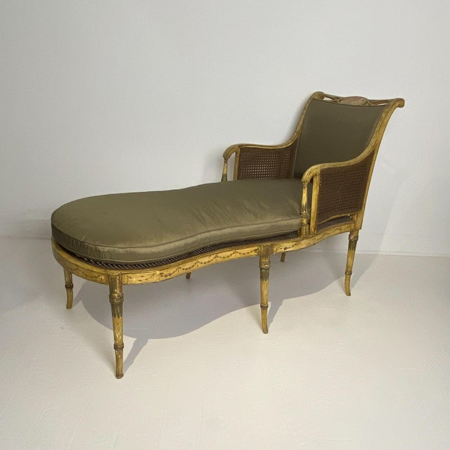 A fainting chair, original paint with neoclassical themes and caned frame. Faux bamboo style, England circa 1810 .