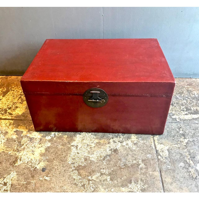 This is a large Chinese lacquered pigskin lacquered trunk that dates to the earlt 20th c. The trunk is in overall good...