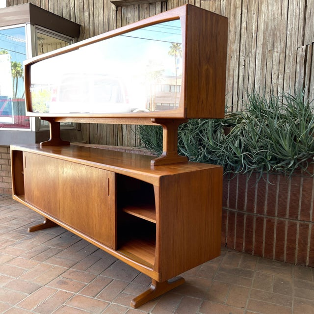 Wonderful Danish Modern Teak Credenza with Floating Top is full of functionality and style. The 2 piece set is comprised...