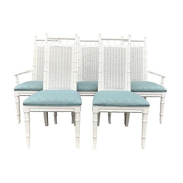 Set of five professionally lacquered tall faux-bamboo dining chairs with woven-wicker backs and newly upholstered seats in...