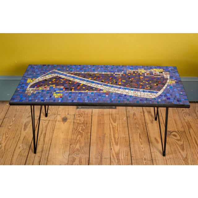 Mosaic cocktail or Coffee table with vibrant tiled top. Iron top-edge and legs.