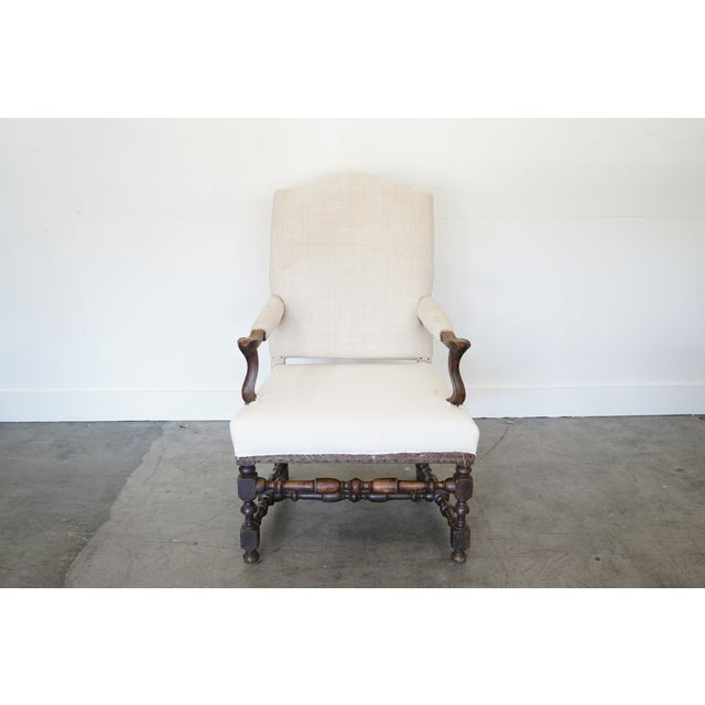 This is an 18th century France transitional Louis XIV style arm chair with typical features of the period and style, a...