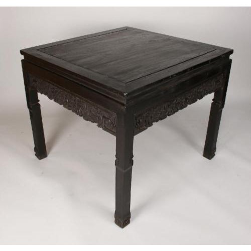 Gorgeous Intricately Carved Chinese Zitan Wood Painting Table. A square Zitan table with a carved apron of dragons and...
